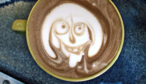 face in a cup of coffee