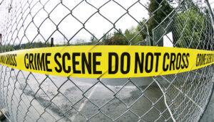 crime scene tape on fence