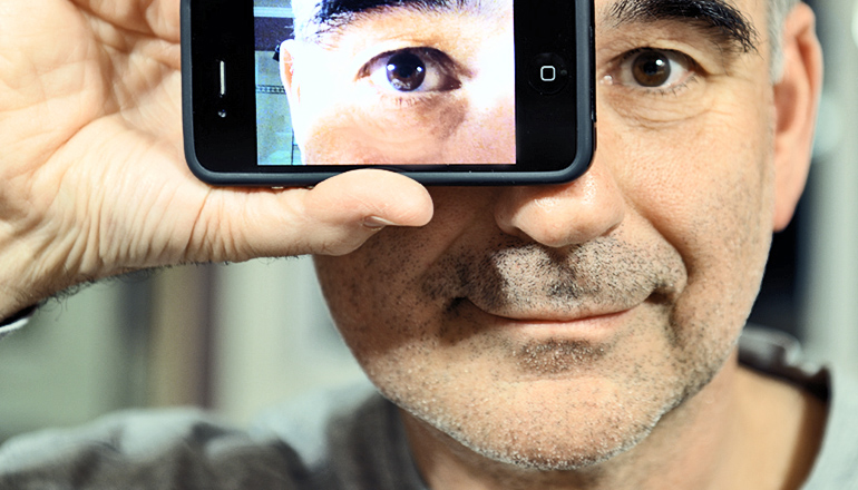 Monitor glaucoma with an eye implant and a phone