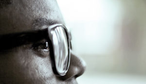 profile portrait of man wearing eyeglasses