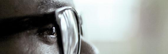profile portrait of man wearing eyeglasses