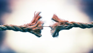 frayed rope connected by a string