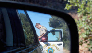 police officer in car mirror
