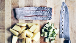 salmon and vegetables on cutting board
