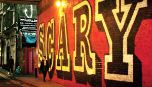 """The word """"scary"""" painted on a wall"""