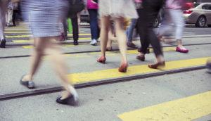 women commuters on a street