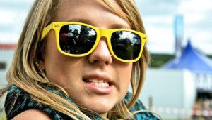 girl wearing yellow sunglasses
