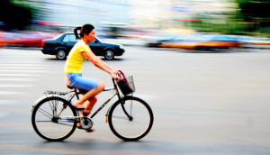 woman rides a bike in Beijing, China.