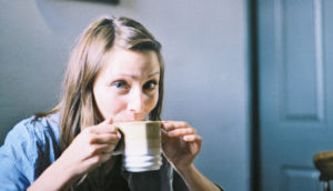 woman sips coffee