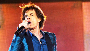 Mick Jagger sings into microphone