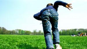 kid runs away across a field