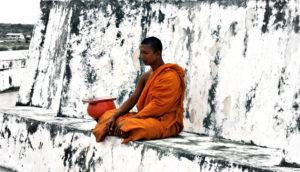 monk meditates in Thailand