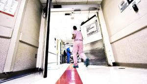 A nurse runs to care for a patient