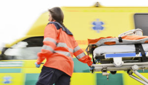 paramedic runs with a stretcher