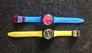 two Swatch watches