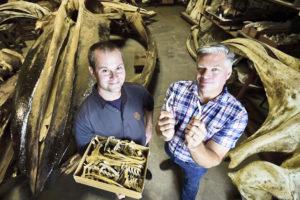 Matt Dean and Jim Dines hold whale bones