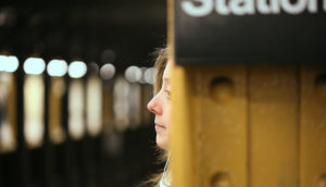 woman waiting for a subway train