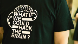 "shirt says ""what if we could hack the brain?"""