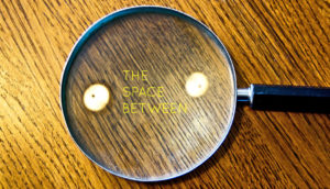 magnifying glass and two dots of light