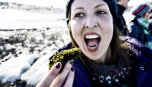 woman pretends to eat moss