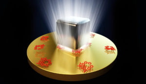 illustration of ight trapped between a silver nanocube and a thin sheet of gold.