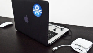 Apple laptop with a FrostWire sticker