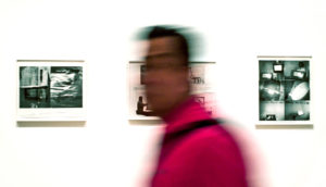 blurry man in art museum