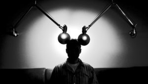 silhouette of man with two lamps near his head