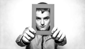 depressed man holding frame