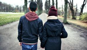teen couple walking away