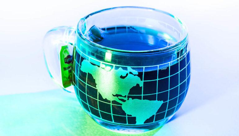 Earth globe cup of tea