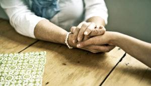 women hold hands