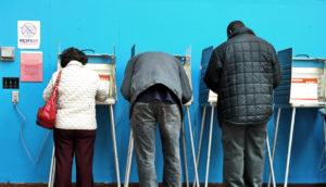 three people voting