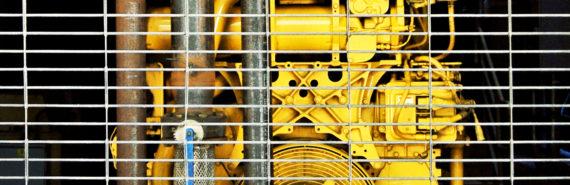 yellow generator behind bars