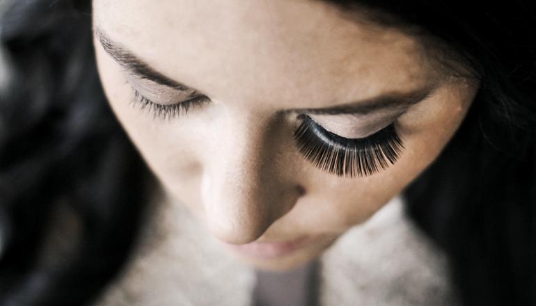 one false eyelash on woman