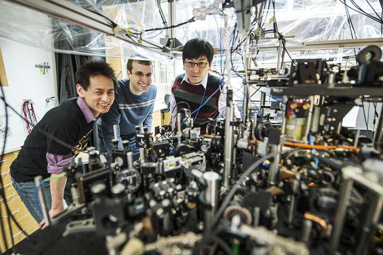 graduate students Li-Chung Ha and Logan Clark and Professor Cheng Chin