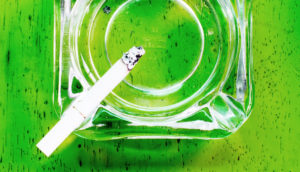 lit cigarette gives off secondhand smoke