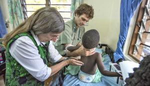 doctors take child's vitals