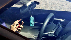 hands texting while driving car