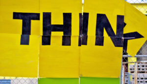 yellow sign says THINK