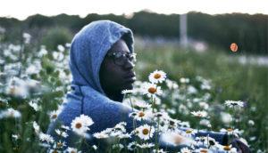 thoughtful man in field of flowers