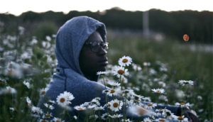 thoughtful man in field of flowers