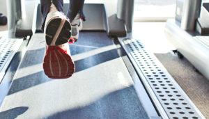 sneakers of runner on treadmill