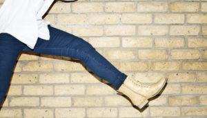 woman wearing jeans leaps