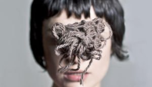 yarn in front of face