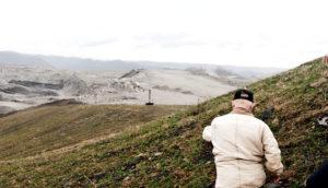 man walks toward coal mine