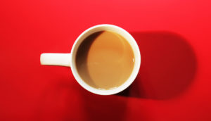 mug of coffee on red