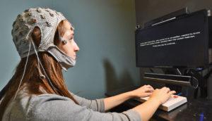 woman has brain activity measured