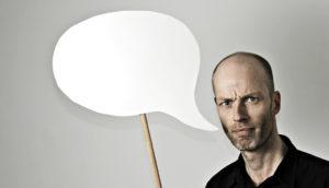 man with speech bubble - grammar