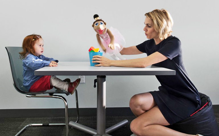 researcher shows child a puppet